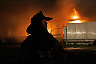 Chicago firefighters battle a five-alarm blaze near 15th and Ashland early on October 19, 2005 in Chicago. (For the Chicago Tribune)