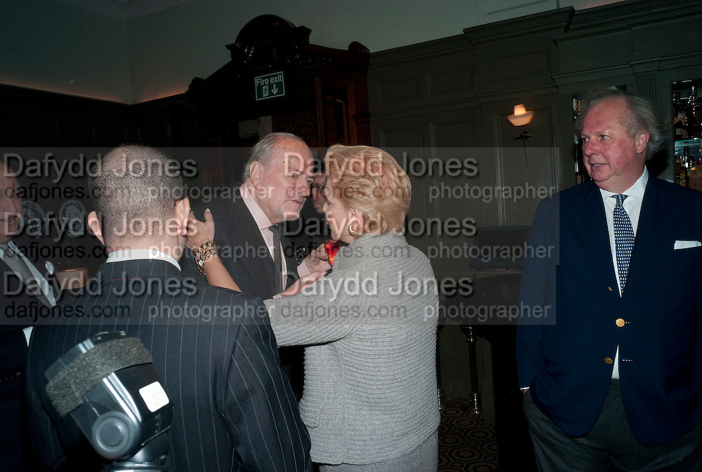 JONATHAN NEWHOUSE; CLAUS VON BULOW; GRAYDON CARTER; CAROLINA HERRERA, , Graydon and Anna Carter host a lunch for Carolina Herrera to celebrate the ipening of her new shop on Mount St. .The Connaught. London. 20 January 2010