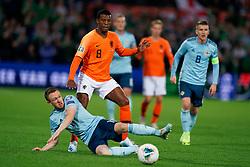 10-10-2019 NED: Netherlands - Northern Ireland, Rotterdam<br /> UEFA Qualifying round Group C match between Netherlands and Northern Ireland at De Kuip in Rotterdam / Shane Ferguson #11 of Northern Ireland, Georginio Wijnaldum #8 of the Netherlands