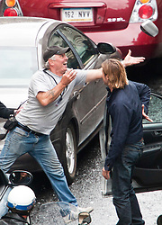 """Day two of filming. Brad Pitt throws his cars broken wing mirror to a crew member on the set of the movie """"World War Z"""" being shot in the city centre of Glasgow. The film, which is set in Philadelphia, is being shot in various parts of Glasgow, transforming it to shoot the post apocalyptic zombie film.."""