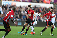 Michael Carrick of Manchester Utd © in action . Premier league match, Swansea city v Manchester Utd at the Liberty Stadium in Swansea, South Wales on Sunday 6th November 2016.<br /> pic by  Andrew Orchard, Andrew Orchard sports photography.