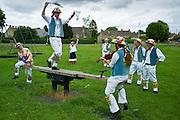 Morris dancers, Icknield Way Morris Men, in children's playground at The Kings Head Pub, Bledington, Oxfordshire, UK
