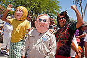 May 29 - PHOENIX, AZ: A street theatre troupe pretends to deport an undocumented immigrant during an immigration march in Phoenix, AZ, Saturday. Actors were portraying the immigrant, Maricopa County Sheriff Joe Arpaio, AZ. Gov. Jan Brewer and AZ State Senator Russell Pearce. More than 30,000 people, supporters of immigrants' rights and opposed to Arizona SB1070, marched through central Phoenix to the Arizona State Capitol Saturday. SB1070 makes it an Arizona state crime to be in the US illegally and requires that immigrants carry papers with them at all times and present to law enforcement when asked to. Critics of the law say it will lead to racial profiling, harassment of Hispanics and usurps the federal role in immigration enforcement. Supporters of the law say it merely brings Arizona law into line with existing federal laws.  Photo by Jack Kurtz