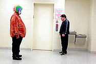 """Reginald Miller, 17, left, waits to catch an elevator after performing a dance routine with New Life World Ministries.  """"Everything I do, I do for God's glory, nothing is for myself,"""" he said."""