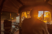 This befuddled autorickshaw was supposed to be taking us to the primo destination for sunset gazing in Pune, but got lost. We watched the dazzling display in the sky from the back of the autorickshaw.