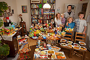 Hamburg, Germany. Family portrait of the Sturm family with one week's worth of food in June. The Hungry Planet project.
