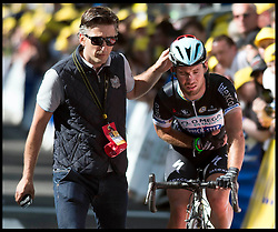 Image ©Licensed to i-Images Picture Agency. 05/07/2014. Yorkshire, United Kingdom.Mark Cavendish limps over the the Tour de France finish line in Harrogate on stage one of the race after a fall  just  short of the finish line . Picture by Andrew Parsons / i-images