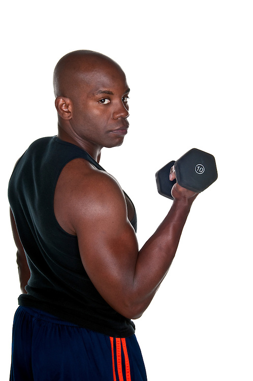 Portrait of young african american bodybuilder doing exercise.