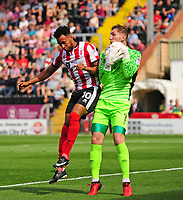 Lincoln City's Matt Green vies for possession with Carlisle United's Jack Bonham<br /> <br /> Photographer Andrew Vaughan/CameraSport<br /> <br /> The EFL Sky Bet League Two - Lincoln City v Carlisle United - Saturday 26th August 2017 - Sincil Bank - Lincoln<br /> <br /> World Copyright © 2017 CameraSport. All rights reserved. 43 Linden Ave. Countesthorpe. Leicester. England. LE8 5PG - Tel: +44 (0) 116 277 4147 - admin@camerasport.com - www.camerasport.com