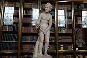A sculpture of Cupid, a 2nd century Roman copy of a Greek original, in the Enlightenment Gallery of the British Museum, on 11th April 2018, in London, England.