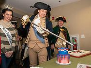 John Godzeiba, portraying General George Washington uses his sword to cut the cake during Washington's 288th Birthday celebration  Sunday, February 16, 2020 at Washington Crossing State Park in Washington Crossing, Pennsylvania. (WILLIAM THOMAS CAIN/PHOTOJOURNALIST)