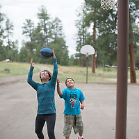 Cynthia Stewart, left, and Darin Bryant play a game pf basketball at the Kiwanis campground Vanderwagon September 27 during the Northwest New Mexico Pride gathering.