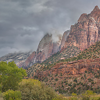 Storm clouds move slowly through the canyons of Zion, like memories of a vanished world long gone.