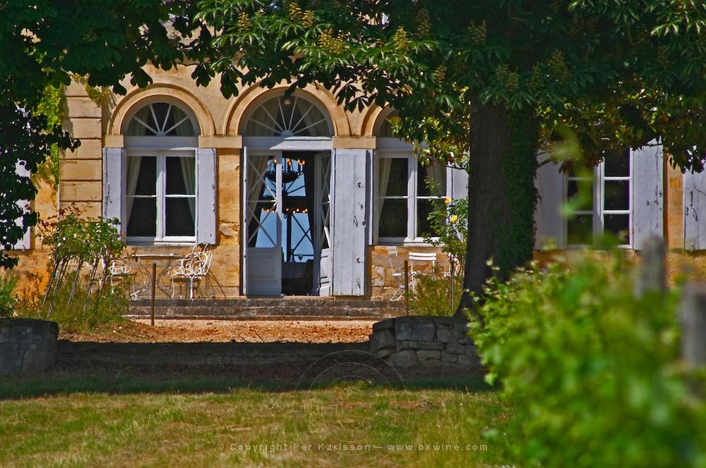 The chateau garden with metal garden furniture a sunny summer day Chateau de Haux Premieres Cotes de Bordeaux Entre-deux-Mers Bordeaux Gironde Aquitaine France