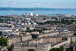 View over rooftops of the New Town towards Leith and the Forth Estuary in Edinburgh, Scotland, United Kingdom