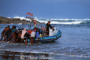 A surf launch from the beach is the only way to get a boat out on much of the east coast of South Africa. Miksikaba River mouth, Transkei or Wild Coast, South Africa ( Indian Ocean )