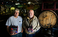 Cricket Hill Brewing owners Ed Gangi and Rick Reed, who founded the company, near one of the bourbon barrels where they age some types of beer. Cricket Hill Brewing in Fairfield celebrates their 15th anniversary. Founder Rick Reed and co-owner Ed Gangi talk about the milestone and the beer.<br /> MOR 1015 Cricket Hill Brewing turns 15