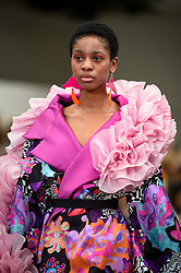 © Licensed to London News Pictures. 02/06/2019. LONDON, UK.  A model presents a look by Lisa Gerstenfeld from Cambridge School of Visual and Performing Arts in the GFW Collective show on day one of Graduate Fashion Week taking place at the Old Truman Brewery in East London.  The event presents the graduation show of up and coming fashion designers from UK and international universities.  Photo credit: Stephen Chung/LNP