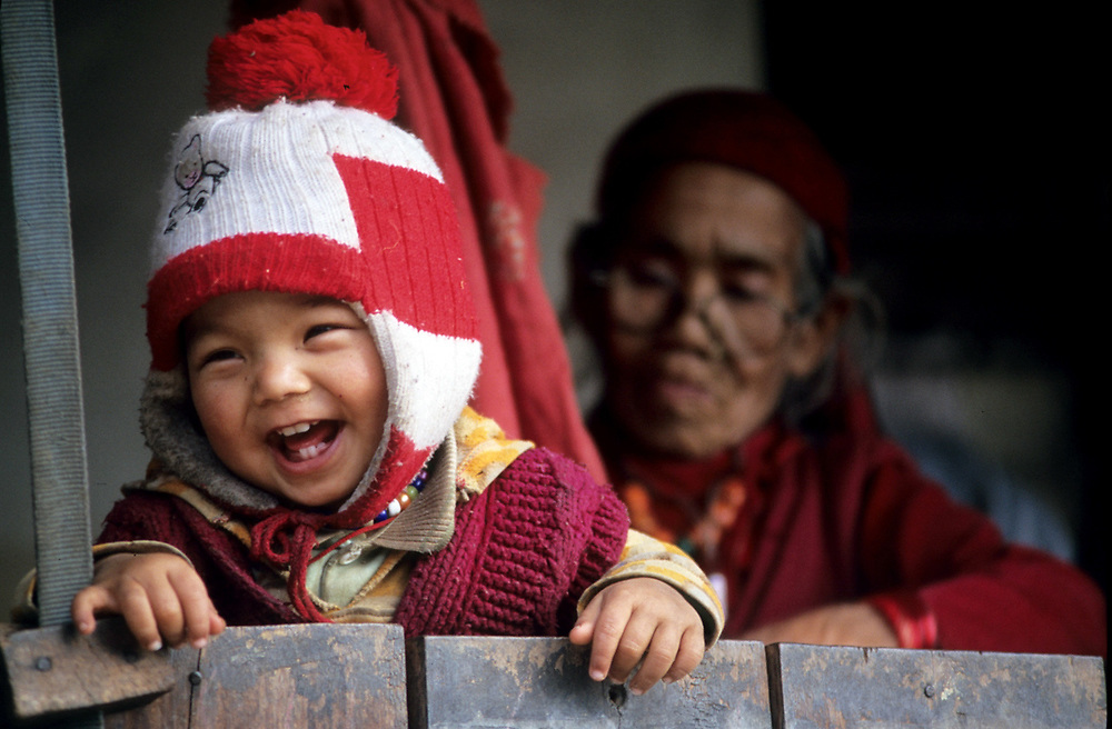 Gurjung Village, Himalaya, Nepal.<br /> The one years old Anuj Gurung is enjoying the time with the 93 years old grandmother. <br /> Photo by Lorenz Berna