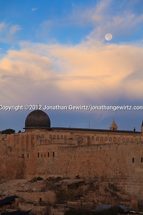 The dome of the Al Aqsa mosque under a setting Moon around sunrise. WATERMARKS WILL NOT APPEAR ON PRINTS OR LICENSED IMAGES.