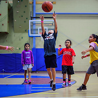 Chris Yazzie gets a shot past the opposing defense during a scrimmage at the True Hoops Basketball Camp Thursday at Rehoboth High School.
