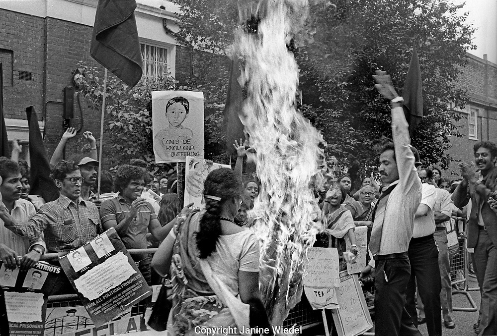 Burning Sri Lankan flag at Eelam Tamil protest in London during Black July 1983 when there was a Sinhalese led anti-Tamil Pogrom, riot and massacre in Sri Lanka. It marked the beginning of the Sri Lankan Civil War between Tamil militants and the Government in Sri Lanka. Over 3,000 Tamils were murdered and over 150.000 people made homeless. Many Tamils fled to other countries forming Tamil diaspora communities.