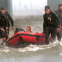 A women is rescued after Tropical Storm Francis flooded her home.    (Photo by Kim Christensen)