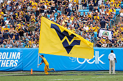 Sep 1, 2018; Charlotte, NC, USA; A West Virginia Mountaineers cheerleader celebrates during the third quarter against the Tennessee Volunteers at Bank of America Stadium. Mandatory Credit: Ben Queen-USA TODAY Sports