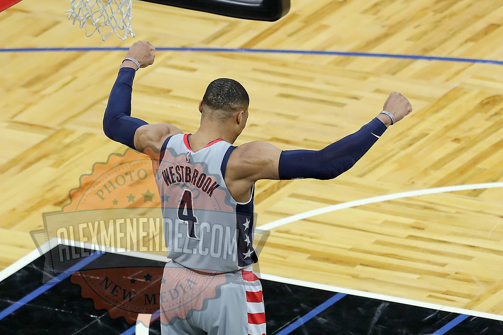 ORLANDO, FL - APRIL 07: Russell Westbrook #4 of the Washington Wizards flexes against the Orlando Magic at Amway Center on April 7, 2021 in Orlando, Florida. NOTE TO USER: User expressly acknowledges and agrees that, by downloading and or using this photograph, User is consenting to the terms and conditions of the Getty Images License Agreement. (Photo by Alex Menendez/Getty Images)*** Local Caption *** Russell Westbrook