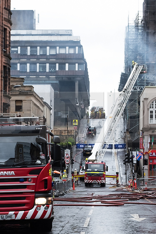© Licensed to London News Pictures. 16/06/2018. Glasgow, UK. Firefighter remain at the scene of a fire at the Glasgow School of Art after the building was damaged in 2014. The large blaze also spread to neighbouring music venue, the O2 ABC.Photo credit: Max Bryan/LNP