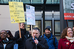 London, UK. 22nd January, 2019. Mike Amesbury, Labour MP for Weaver Vale, addresses support staff at the Department for Business, Energy and Industrial Strategy (BEIS) represented by the Public and Commercial Services (PCS) union on the picket line after beginning a strike for the London Living Wage of £10.55 per hour and parity of sick pay and annual leave allowance with civil servants. The strike is being coordinated with receptionists, security staff and cleaners at the Ministry of Justice (MoJ) represented by the United Voices of the World (UVW) trade union.