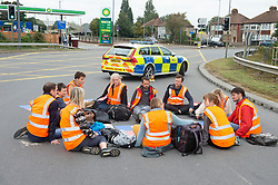 © Licensed to London News Pictures 15/09/2021. <br /> Dartford, UK, Insulate Britain protesters have glued themselves to the road on a roundabout at Junction 1b next to the M25 in Dartoford, Kent. Photo credit:Grant Falvey/LNP