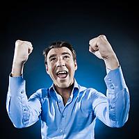 caucasian man happy success portrait isolated studio on black background
