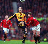 Sami Hyypia (Liverpool) holds off Ole Gunnar Solskjaer (Man Utd). Manchester United's first home defeat in the Premiership for two years. Manchester United v Liverpool. FA Premiership, 17/12/2000. Credit: Colorsport / Andrew Cowie.