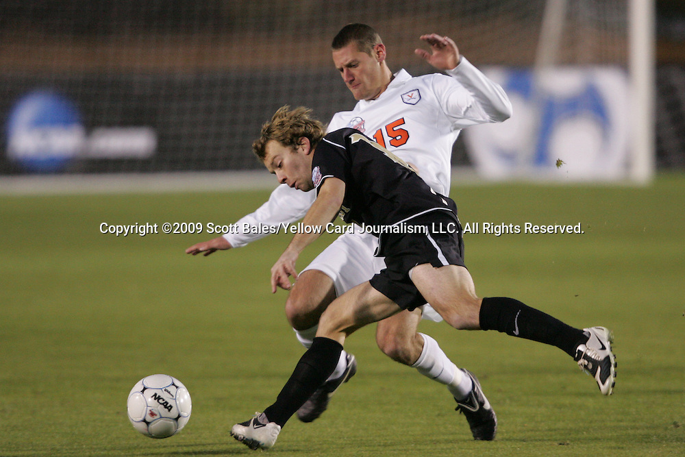 11 December 2009: Wake Forest's Zack Schilawski (front) and Virginia's Mike Volk (15). The University of Virginia Cavaliers defeated the Wake Forest University Demon Deacons 2-1 in overtime at WakeMed Soccer Stadium in Cary, North Carolina in an NCAA Division I Men's College Cup Semifinal game.