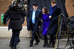 © Licensed to London News Pictures. 14/01/2017. London, UK. Labour Party leader JEREMY CORBYN being questioned by media as he arrives to speak at the Fabian Society conference in London, with JAMES SCHNEIDER (right), Head of Strategic Communications. Corbyn has come under further pressure as leader following the resignation of Stoke-on-Trent, Tristram Hunt. Photo credit: Ben Cawthra/LNP