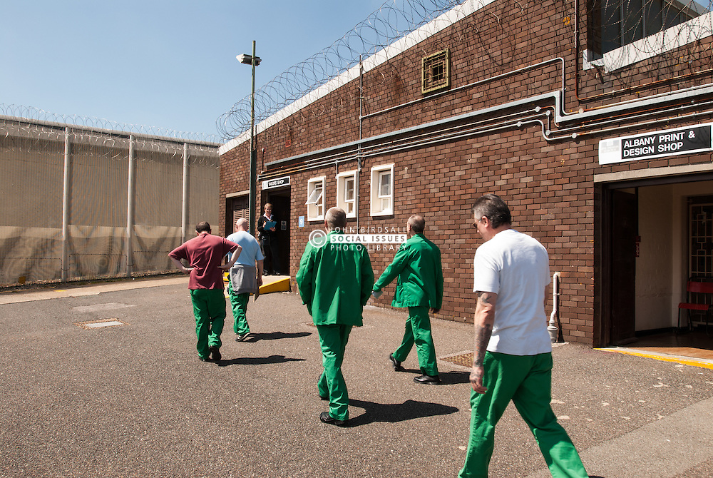 Prisoners going into tailors workshop in UK prison