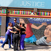 Staff members of Whole Woman's Health celebrate in front of a mural on the side of the building after the U.S. Supreme Court ruling against Texas' abortion restrictions in front of Whole Woman's Health in downtown McAllen.<br /> Nathan Lambrecht/The Monitor