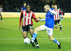 Brentford's Romaine Sawyers and Sheffield Wednesday's Barry Bannan battle for the ball during Sheffield Wednesday v  Brentford at Hillsborough.