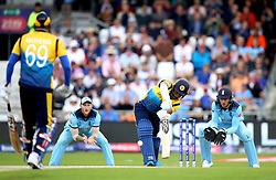 Sri Lanka's Jeevan Mendis (centre) gets out first ball for a golden duck caught and bowled by England's Adil Rashid during the ICC Cricket World Cup group stage match at Headingley, Leeds.