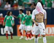 Peru forward Paolo Guerrero (9) puts his shirt over his head after Mexico midfielder Fernando Arce scored during the first half of a soccer match at Soldier Field in Chicago, Sunday, June 8, 2008. (AP)