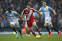 Middlesbrough's George Friend outpaces Blackburn Rovers Lee Williamson and  Tom Cairney<br /> <br /> Photographer Mick Walker/CameraSport<br /> <br /> Football - The Football League Sky Bet Championship - Blackburn Rovers v Middlesbrough - Sunday 28th December 2014 - Ewood Park - Blackburn<br /> <br /> © CameraSport - 43 Linden Ave. Countesthorpe. Leicester. England. LE8 5PG - Tel: +44 (0) 116 277 4147 - admin@camerasport.com - www.camerasport.com