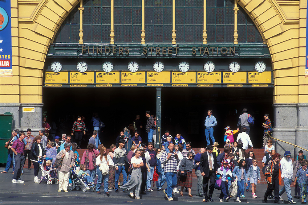 Australia, Victoria, Crowds walk past Flinders Street Train Station in downtown Melbourne