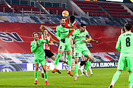 Michael Luftner of Omonia Nicosia competes for the headed ball with Denzel Dumfries of PSV during the UEFA Europa League, Group E football match between PSV and Omonia Nicosia on December 10, 2020 at Philips Stadion in Eindhoven, Netherlands - Photo Perry vd Leuvert / Orange Pictures / ProSportsImages / DPPI