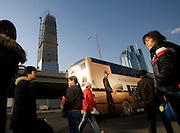 A bus stop near the construction site of the China World's Tower in the CBD.