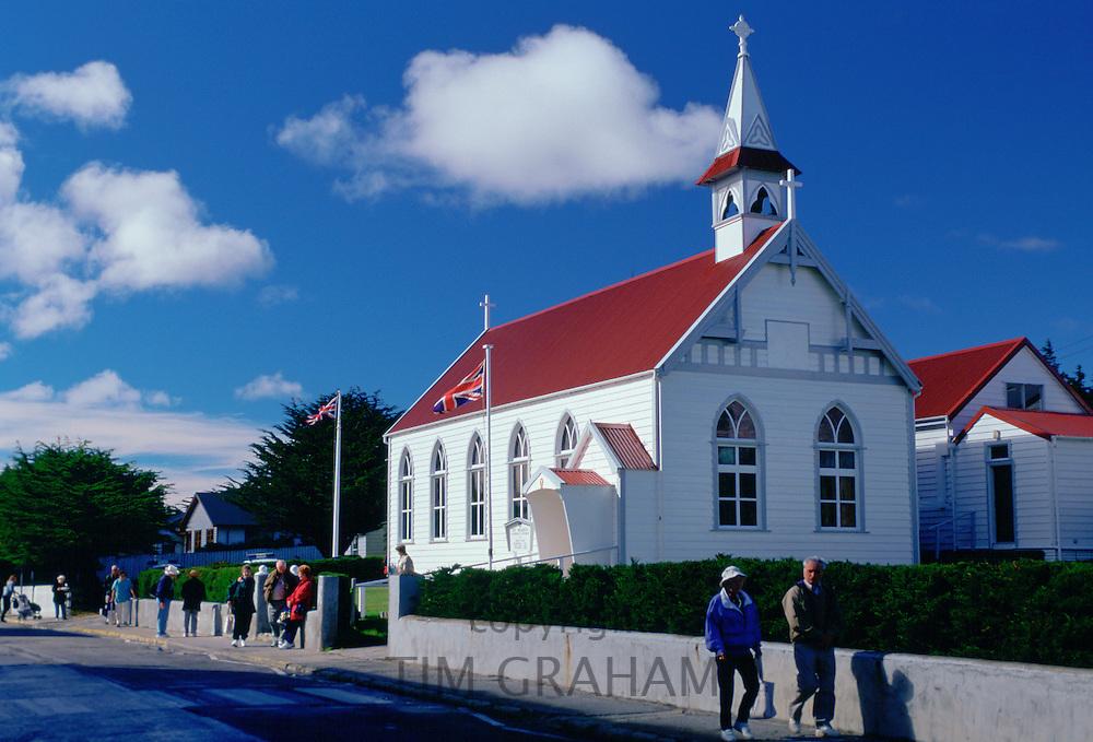 People walking along Main Street in Port Stanley, Falkland Islands