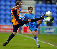 Photo: Chris Brunskill. Wigan Athletic v Millwall. Coca-Cola Championship. 12/03/2005. Leighton Baines of Wigan challenges for the ball with Mark Quigley of Millwall.