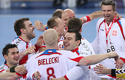 Team of Poland celebrates after winning the 21st Men's World Handball Championship 2009 Bronze medal match between National teams of Poland and Denmark, on February 1, 2009, in Arena Zagreb, Zagreb, Croatia.  Won of Poland 31:23. (Photo by Vid Ponikvar / Sportida)