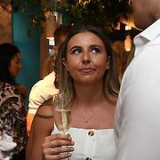 Food and lifestyle bloggers/influencers and journalists attend the Oppo party to launch its new Madagascan Vanilla, Sicilian Lemon and Raspberry Cheesecakes, served with Skinny Prosecco at Farm Girls Café, 1 Carnaby Street, Soho, London, UK on July 18 2018.