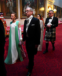 Lindsay Reynolds and the Prime Minister's husband Philip May arrive through the East Gallery during the State Banquet at Buckingham Palace, London, on day one of the US President's three day state visit to the UK.